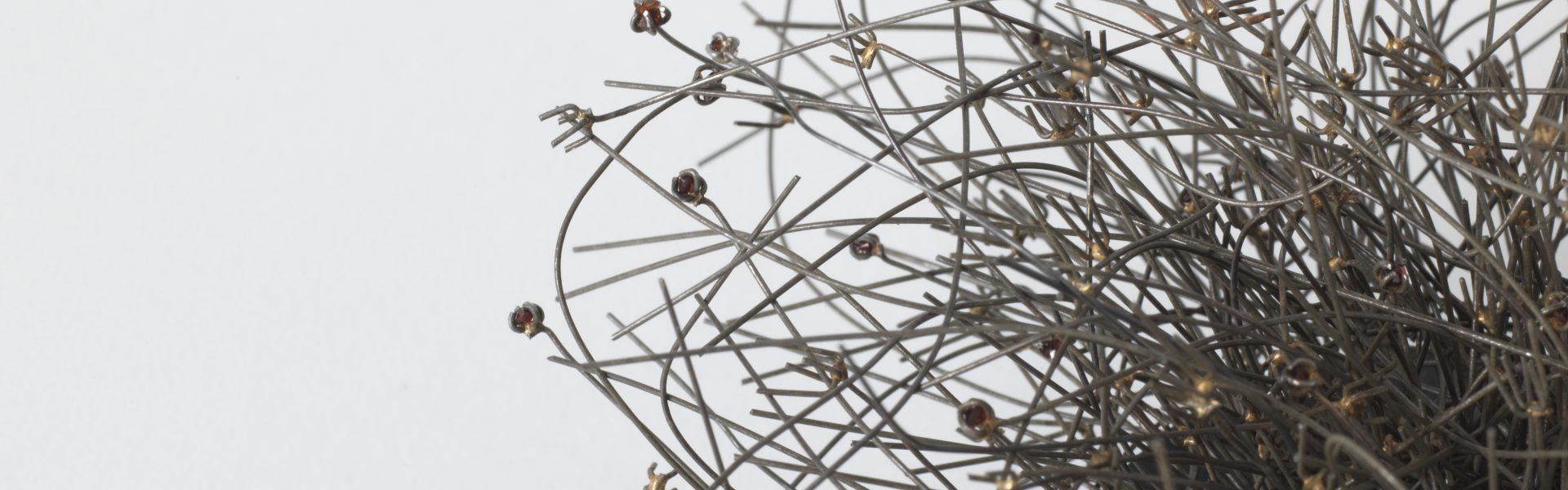 Bettina Dittlmann, brooch, 2018, magnet, iron, garnets, 15 cm, h. 16 cm
